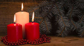 Three burning Christmas candles Stock Images