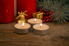 Three burning Christmas candles Royalty Free Stock Image