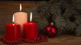Three burning Christmas candles Royalty Free Stock Photos