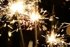 Three burning christmas sparklers. Royalty Free Stock Photos