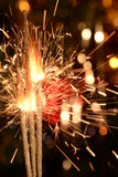 Three burning christmas sparklers. Royalty Free Stock Photo