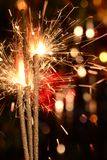 Three burning christmas sparklers. Royalty Free Stock Images