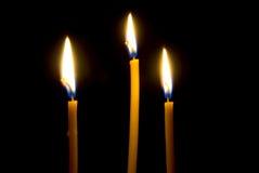 Three burning, church candles. Stock Image