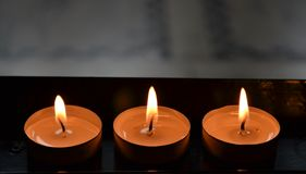 Three burning church candles Royalty Free Stock Images
