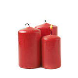 Three burning red candles isolated Royalty Free Stock Image