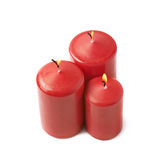 Three burning red candles isolated Stock Images