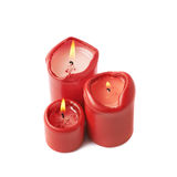 Three burning red candles isolated Stock Photos