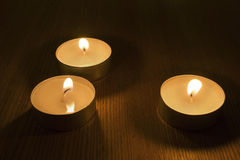Three burning tea lights Royalty Free Stock Image