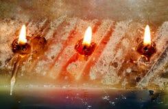 Three Burning Wicks on Large Rectangular Candle Royalty Free Stock Image