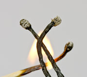 Three burnt down matches Stock Photo