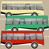 Three buses traveling on the road Royalty Free Stock Images