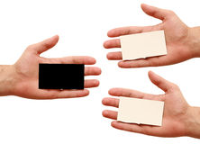 Three business cards in hand. White and black Royalty Free Stock Photography