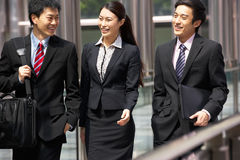 Three Business Colleagues Having Discussion. Whilst Walking Outside Office Stock Images