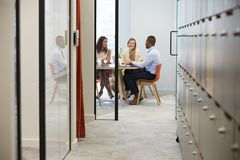 Three business colleagues at an informal office meeting stock photos
