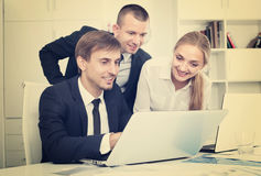 Three business colleagues in office Royalty Free Stock Photography