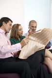 Three business colleagues sitting on sofa Royalty Free Stock Photography