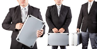 Three business man and metal briefcase Stock Images