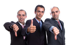 Three business man with thumbs Royalty Free Stock Images