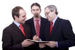 Three business men stock photography