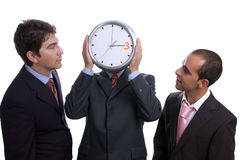 Three business men with clock Royalty Free Stock Photography