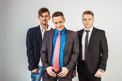 Three business men in suits standing like a team Royalty Free Stock Images