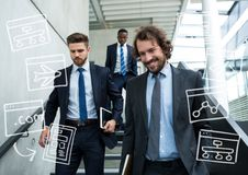 Three business men walking down stairs with white business doodles. Digital composite of Three business men walking down stairs with white business doodles Stock Images
