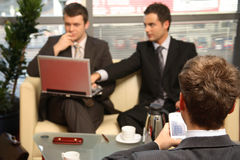 Three Business men working in the office Stock Photo