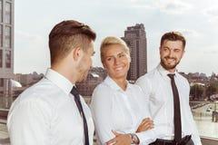Three business partners having conversation Royalty Free Stock Photo