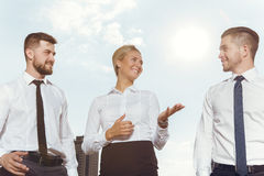 Three business partners having conversation Royalty Free Stock Images