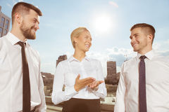 Three business partners having conversation Royalty Free Stock Photography