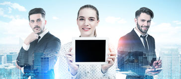 Business partners portrait in a city, tablet Stock Photos