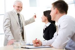 Three business people Royalty Free Stock Photos