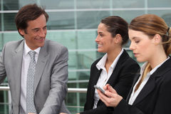 Three business people. Stood outside workplace Royalty Free Stock Photo