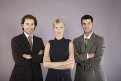 Three Business People With Arms Crossed Stock Photos