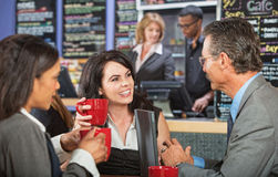 Three Business People in Bistro Stock Photos