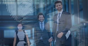 Three business people with blue map graphic overlay Royalty Free Stock Images