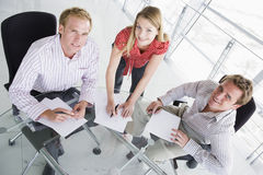 Three business people in a boardroom Royalty Free Stock Photos