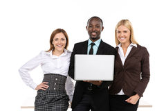 Three business people holding laptop Stock Image