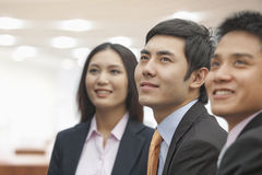 Three Business People Looking Away Stock Images