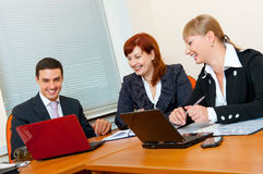 Three business people are meeting royalty free stock images