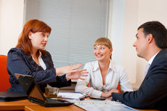 Three business people are meeting royalty free stock image