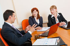 Three business people are meeting stock photos