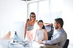 Three business people in the office talking together. Royalty Free Stock Photography