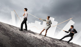 Three business people pulling rope Stock Photos