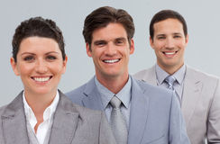 Three business people in a row Stock Photography
