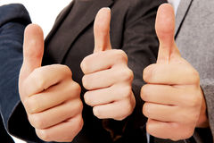 Three business people showing thumbs up Stock Images