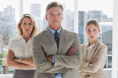 Three business people standing together Stock Photo