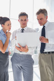 Three business people using a laptop Royalty Free Stock Photography