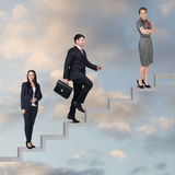 Three business people walking on the ladder Royalty Free Stock Images