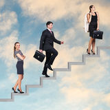 Three business people walking on the ladder Stock Photography